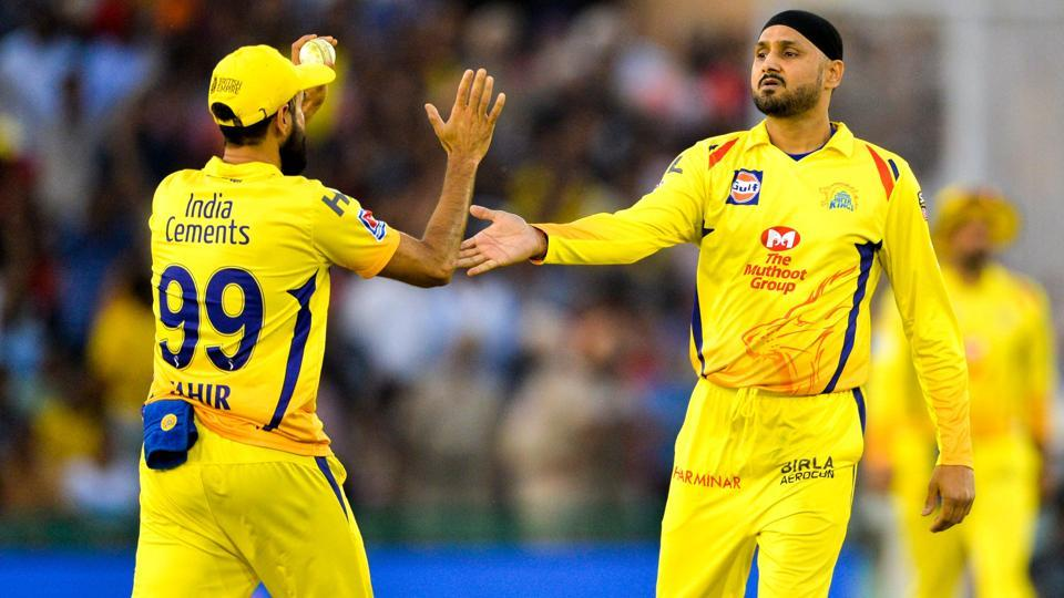 Chennai Super Kings bowler Harbhajan Singh (R) celebrates with his teammate Imran Tahir (L). (AFP)