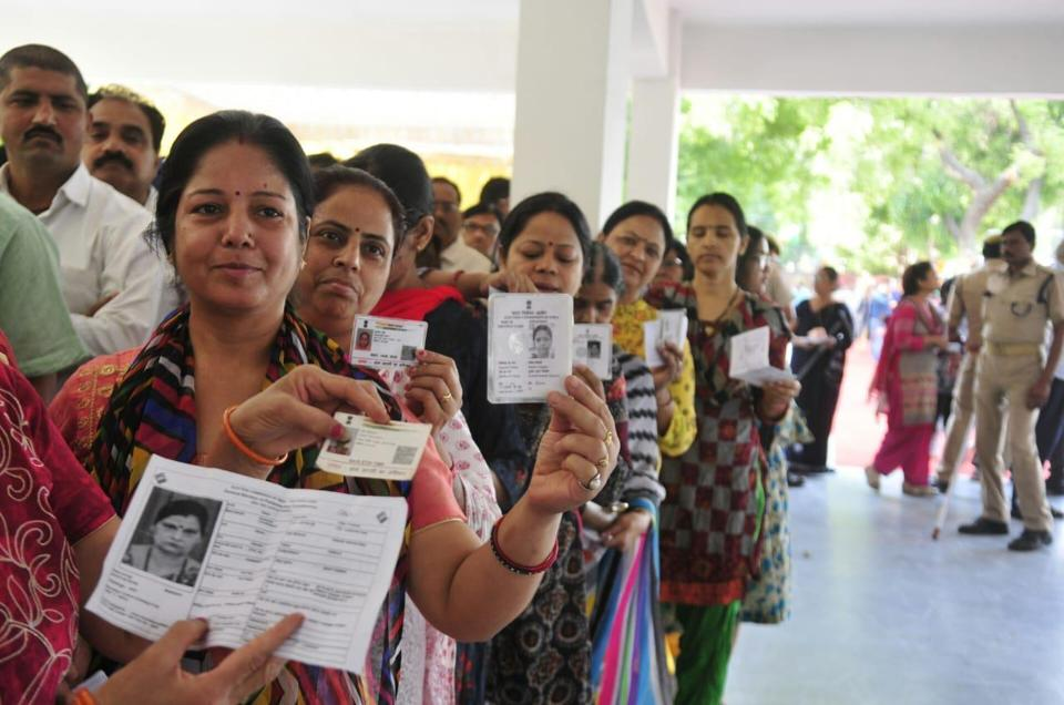 People queue up at a polling station in Lucknow during phase five of Lok Sabha elections.