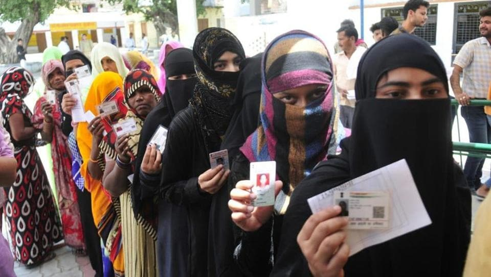 Female voters displaying their inked finger after casting vote during 5th phase of Lok sabha electionhere at Mujasa village Malihabad in Lucknow.