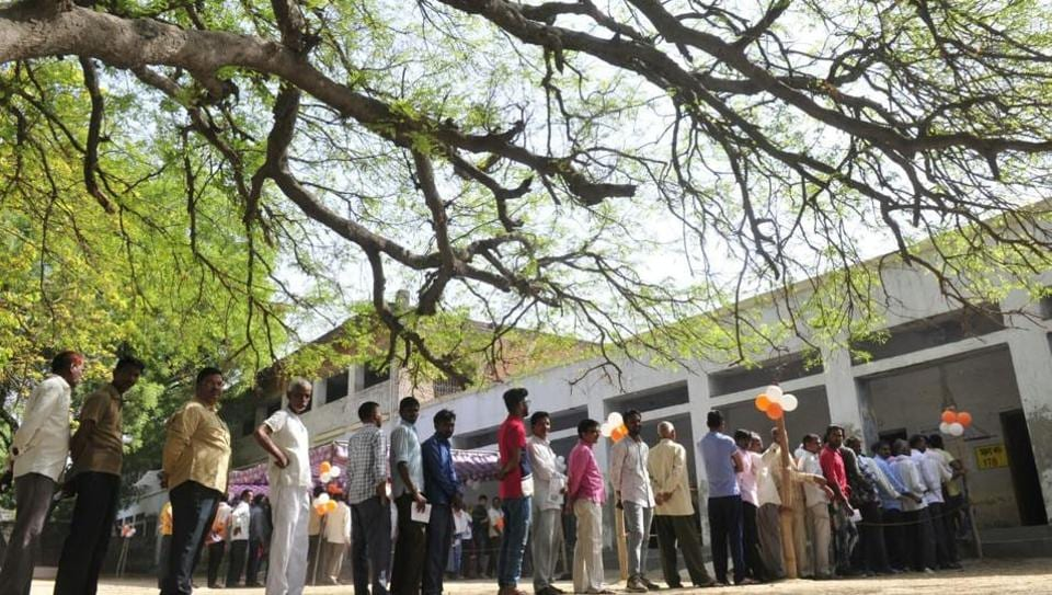 Voters queue to cast their votes during the 5th phase of Lok Sabha election in Mohanlalganj, Lucknow. At 3 pm, the voter turnout in the fifth phase of Lok Sabha elections 2019 stood at 50.62%. 344.08% polling was recorded in Bihar, 15.34% in Jammu and Kashmir, 53.77% in Madhya Pradesh, 50.40% in Rajasthan, 44.79% in Uttar Pradesh, 62.84% in West Bengal and 58.63% in Jharkhand, as per data on Election Commission's Voter Turnout app. (Deepak Gupta / HT Photo)