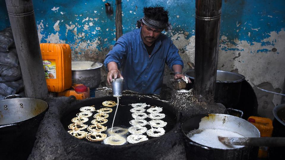 "An Afghan worker prepares sweets ahead of the holy month of Ramzan at a market in Kabul. The Ramzan fast begins with a pre-dawn meal called ""suhoor"" that includes bread, vegetables, fruits, yogurt, tea, as well as lentils and beans. At sunset, when it's time to mark the end of the daylong fast, families and friends gather for an evening meal known as ""iftar."" (Walik Kohsar / AFP)"