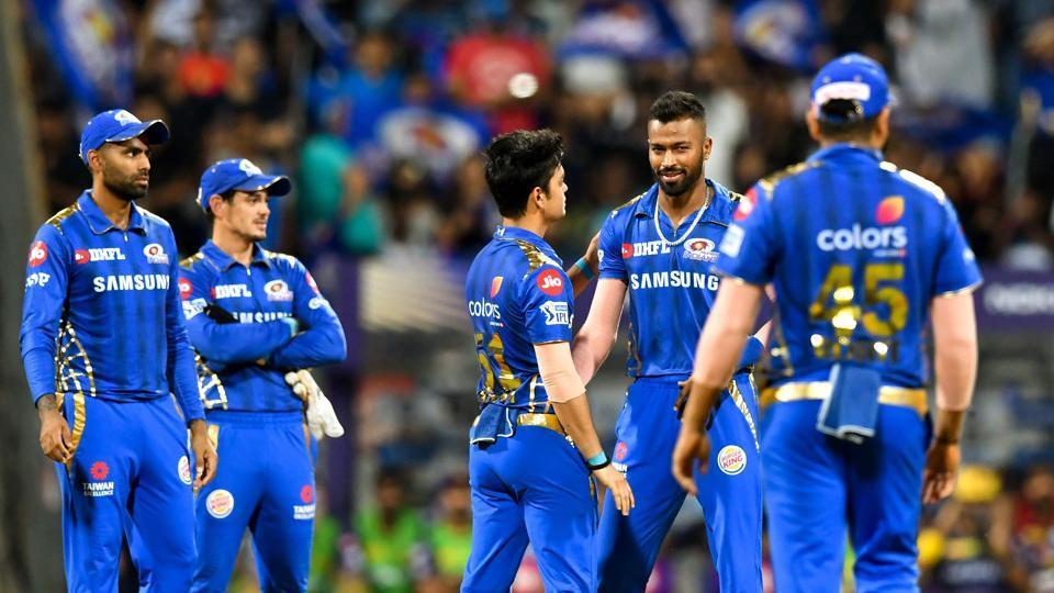 Mumbai Indians bowler Hardik Pandya (2R) celebrates with teammates after taking the wicket of Kolkata Knight Riders batsman Shubman Gill during the 2019 Indian Premier League (IPL)