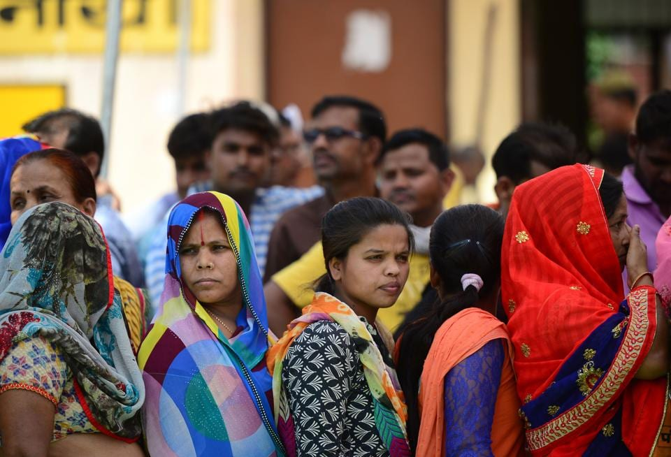 Indian voters queue at a polling station to cast their ballots during the fifth phase of general election in Amethi in Uttar Pradesh state on May 6, 2019.  Image for representation