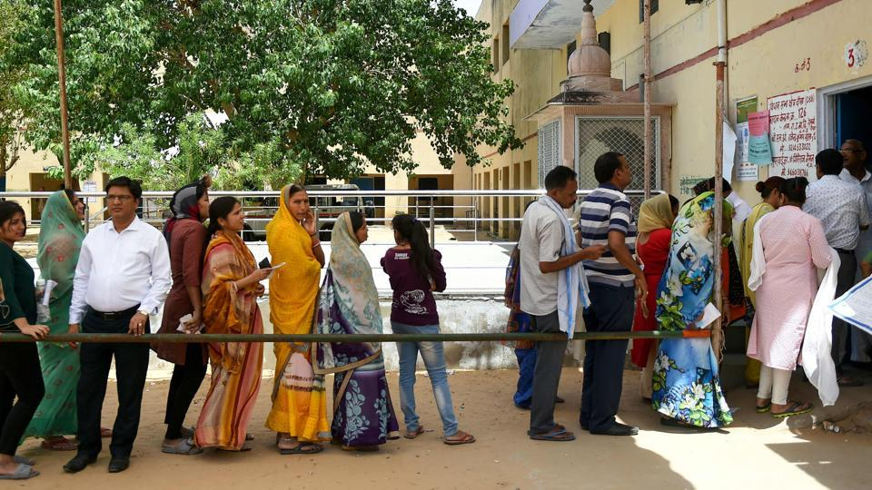 Indian voters queue at a polling station to cast their vote during the fifth phase of India's general election in Dausa in the northern Indian state of Rajasthan on May 6, 2019.