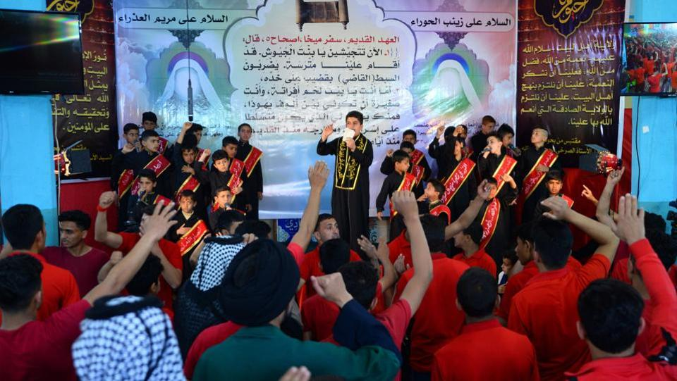 As the black-clad rapper spat lyrics into the microphone on stage, the Iraqi boys below beat their chests in mourning, paying homage to slain Shiite figurehead Hussein. Religion and politics are deeply intertwined in Iraq, where government posts have been allocated according to sect since the US-led invasion in 2003. The country's 40 million people are mostly Shiites, with a burgeoning youth population navigating an increasingly modern society.  (Haidar Hamdani / AFP)