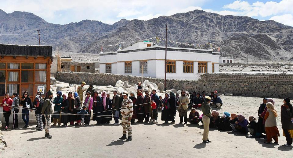 Voters stand in a queue at a polling station in Shey village, Leh. The Ladakh Lok Sabha constituency has an electoral strength of 174,618 voters. (PTI)
