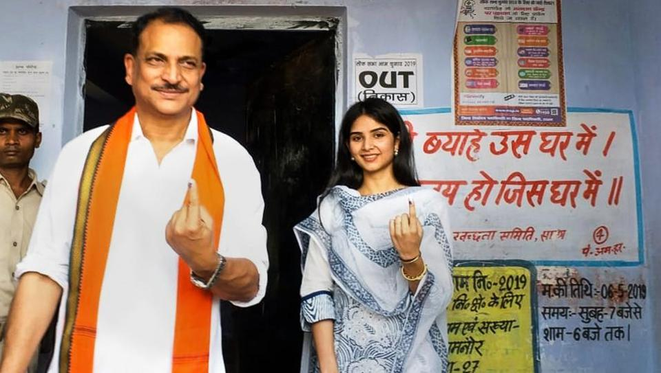 BJP candidate from Saran, Rajiv Pratap Rudy, with his daughter Atisha Pratap shows his inked finger after casting vote at a polling station, during the 5th phase of Lok Sabha polls, in Chhapra, Monday, May 6, 2019.