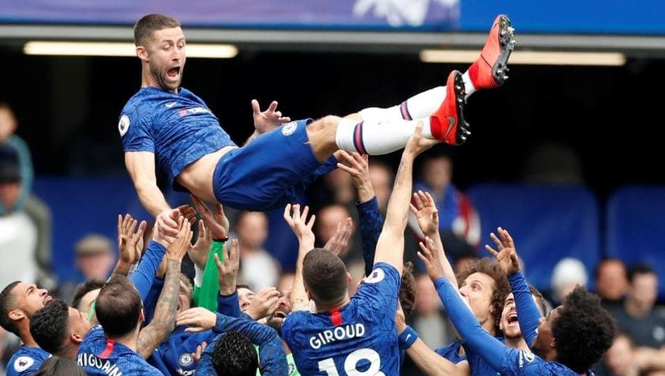 Chelsea's Gary Cahill is thrown in the air by his team mates after the match