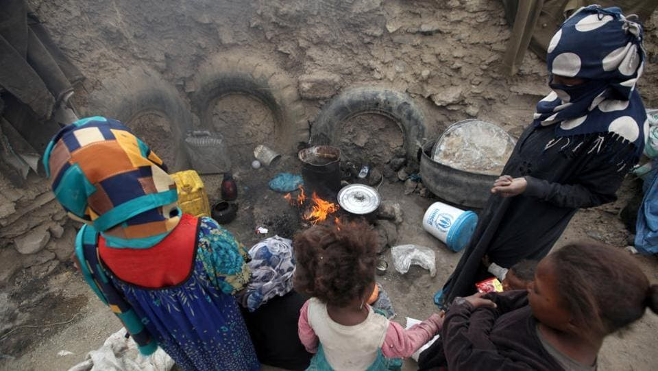 Women cook a meal after they received food aid from the local charity, Mona Relief, ahead of the holy month of Ramzan in a slum on the outskirts of Sanaa, Yemen. (Khaled Abdullah / REUTERS)