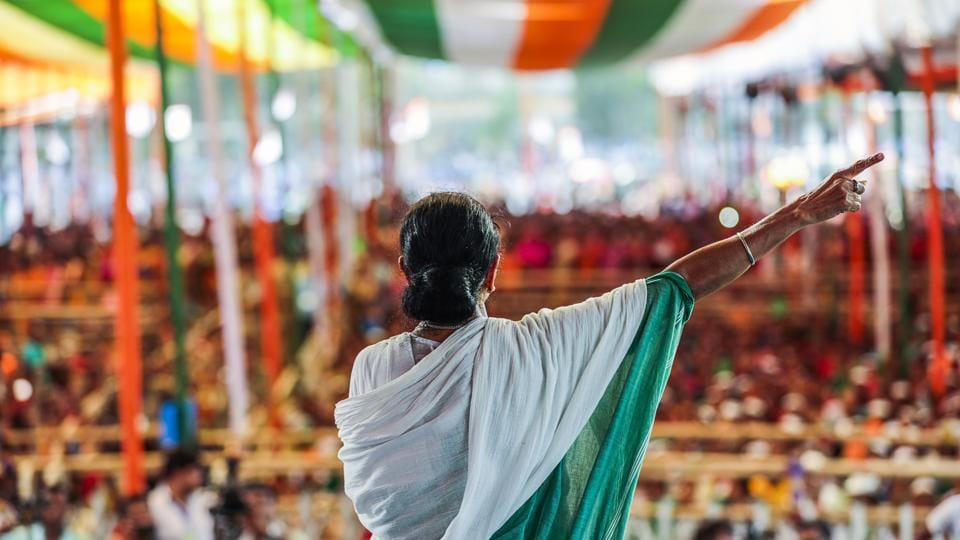 Mamata Banerjee, chief minister of West Bengal, speaks during a rally in Swarupnagar, West Bengal. Leading farmer protests in 2008, Banerjee drove out a Tata Motors factory in Singur, where many like 28-year-old Santu Adhikari hoped to find work. The plant was torn down before it was finished, and Adhikari now spends his days among its ruins hunting for scrap. Adhikari blames his grim predicament on Banerjee. (Prashanth Vishwanathan / Bloomberg)