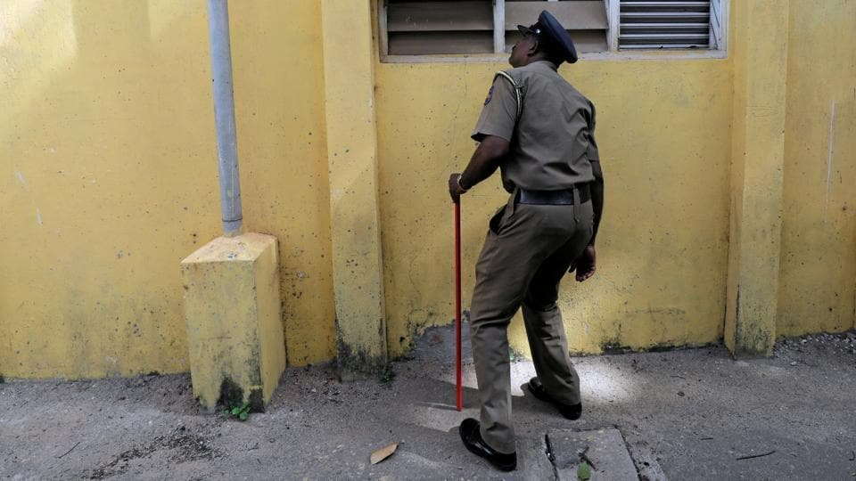 A Sri Lankan police officer searches a school premises ahead of schools' second term starting on May 06. State schools in Sri Lanka resumed classes on Monday amid tight security after the Easter Sunday bombings, but many anxious parents kept their children at home over fears of more attacks by Islamic militants. (Dinuka Liyanawatte / REUTERS)