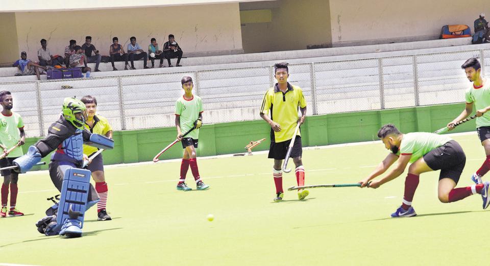 Raja Bangla Sports Club (green) in action against Kids XI at the Dr Babasaheb Ambedkar hockey tournament played at Major Dhyan Chand hockey poligras stadium.