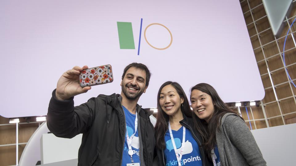 An attendees uses a smartphone to take a selfie photograph during the Google I/O Developers Conference in Mountain View, California, U.S., on Tuesday, May 7, 2019. Each year, Google pitches new ways its trove of user data can improve apps, websites and other services on smartphones. This year, the internet giant will try to convince the world it's a responsible steward of all that information. Photographer: David Paul Morris/Bloomberg