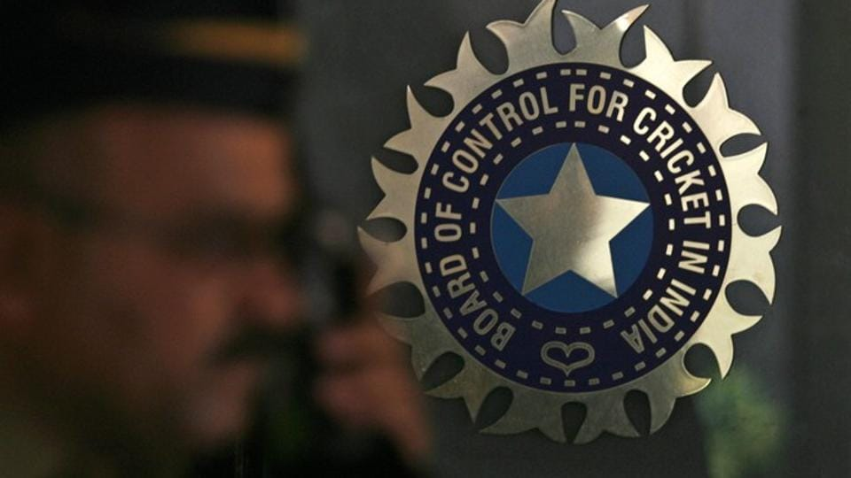 A policeman walks past a logo of the Board of Control for Cricket in India (BCCI) at BCCI headquarters in Mumbai April 26, 2010.