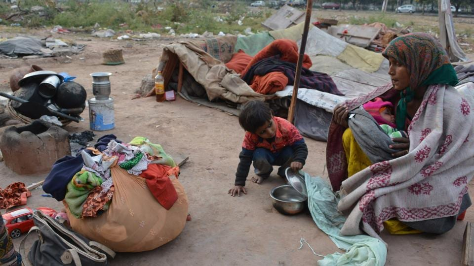 slum dwellers,permanent house,poll