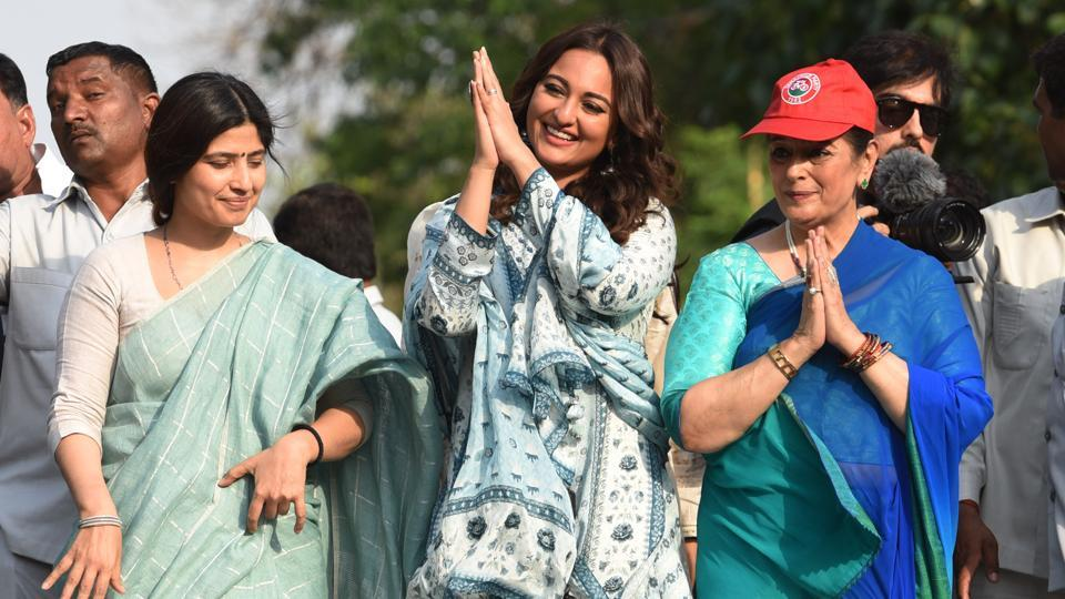 Lok Sabha candidate Poonam Sinha with her daughter Sonakshi Sinha and Samajwadi Party MP Dimple Yadav during a road show in Lucknow.