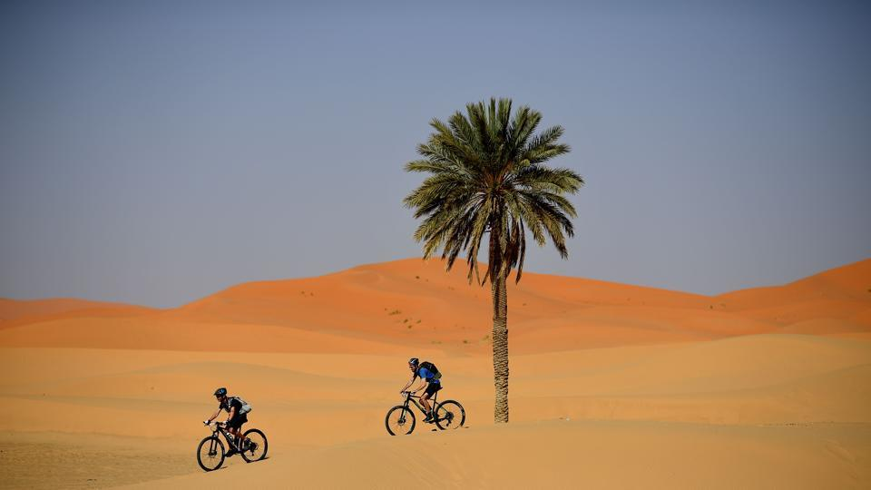 Competitors ride during a training session on April 27, on the eve of the start of the 14rd edition of Titan Desert 2019, around Merzouga in Morocco. The Titan desert 2019 race began at the town of Merzouga and snaked its way to  the final checkpoint at Maadid from April 28 to May 3. (Franck Fife / AFP)