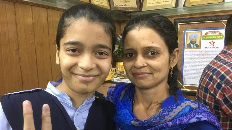 Topper Neha Verma of Teja Singh Sutantar School and her mother Jeeiya Verma at the school premises in Ludhiana, after the declaration of Punjab Board Class 10 results.