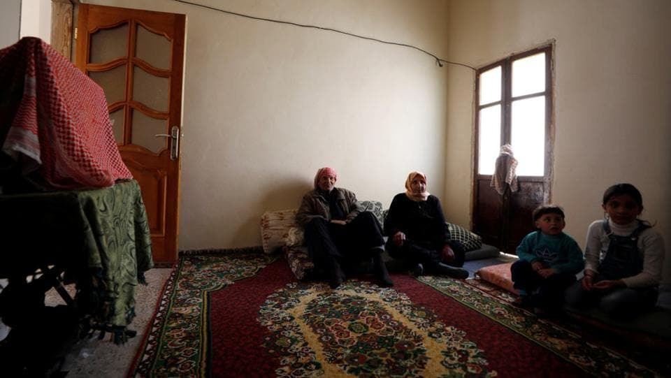 He fled the area at the start of the fighting in 2012 and returned years later when it ended with a government victory, finding his house badly damaged. The 75-year-old and his wife, Aisha, 60, borrowed money to fix the shell-smashed back wall and replaster the inside, where they now live with their daughter Maryam, 30, and her three children. (Omar Sanadiki / REUTERS)