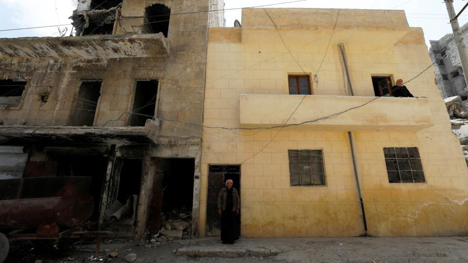 Aoul, a retired stone cutter, said he isn't worried about his house collapsing. However, it would not only put their lives in danger but take almost all they own. The family income rests on a taxi that stands outside the bullet-riddled front door. Aoul rents it to a driver who gives him half the takings. But the driver hasn't shown up for five days. (Omar Sanadiki / REUTERS)