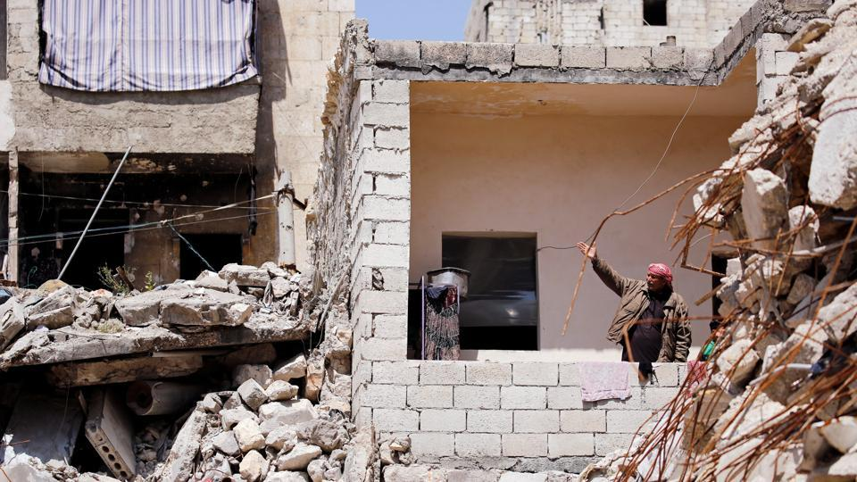When Hassan Ahmed al-Aoul looks from his balcony in Aleppo, little meets his gaze but ruins - great mounds of rubble where his neighbours' houses used to stand. Like many with homes near Aleppo's frontlines, the city areas that suffered most damage in a war now into its ninth year, he makes do with a life in the rubble. (Omar Sanadiki / REUTERS)