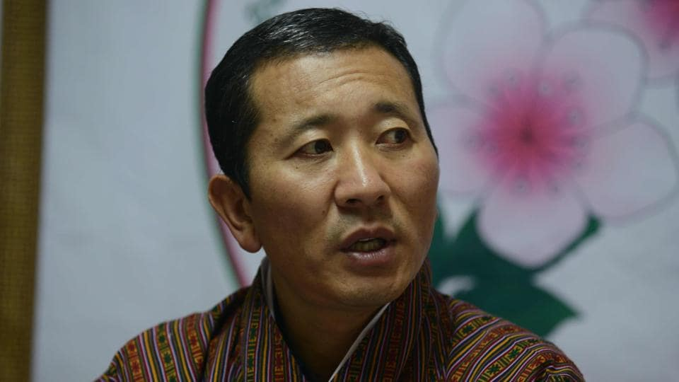 No one at the hospital bats an eyelid as Tshering, wearing a faded lab coat and crocs, walks through the busy corridors