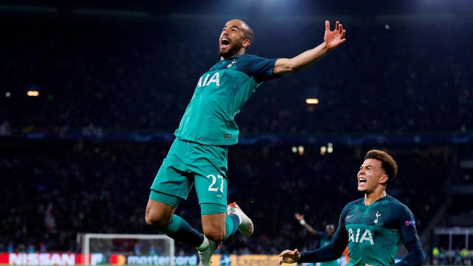 Tottenham's Lucas Moura celebrates scoring their third goal to complete his hat-trick with Dele Alli