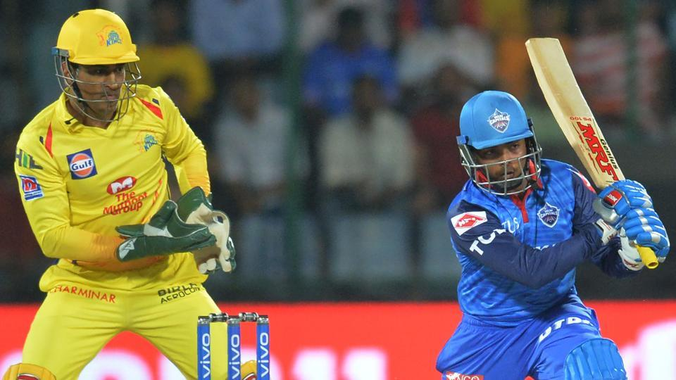 Delhi Capitals cricketer Prithvi Shaw plays a shot as Chennai Super Kings skipper MS Dhoni looks on.
