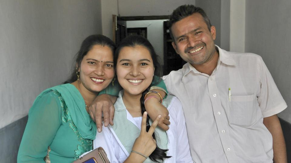 Ritika, a student of BCM Senior Secondary School, Focal Point, celebrating her success with her parents, after Class 10th results of Punjab School Education Board (PSEB) were out in Ludhiana (Photo by Gurminder Singh/Hindustan Times)