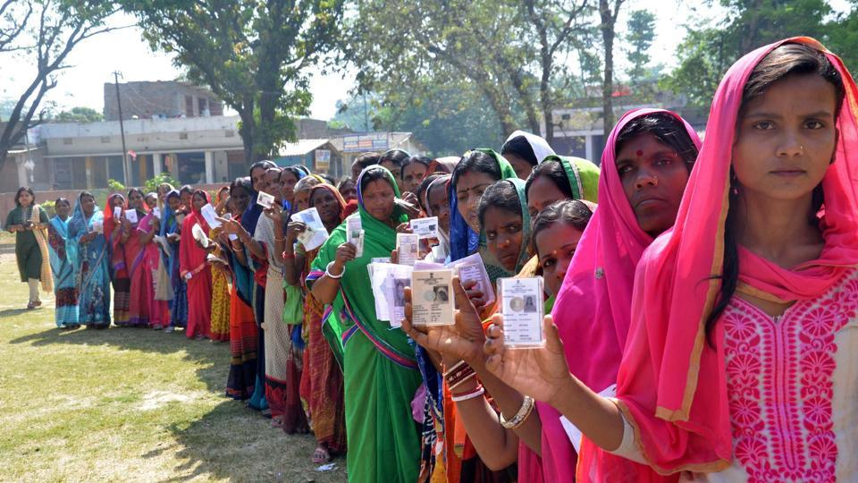 Muzaffarpur-May.6,2019- Voters in a queue with their voter ID cards as they wait in a queue to cast vote at a polling station, during the fifth phase of Lok Sabha elections in Muzaffarpur Bihar India on Monday,May 6,2019.(Photo by Santosh Kumar/Hindustan Times).