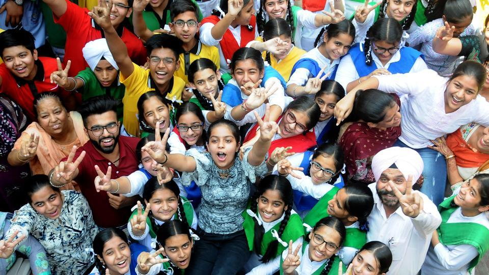 Students and teachers of Sun Flower High School in a jubilant mood after the declaration of the Punjab School Education Board Class-10 results, in Patiala on Wednesda