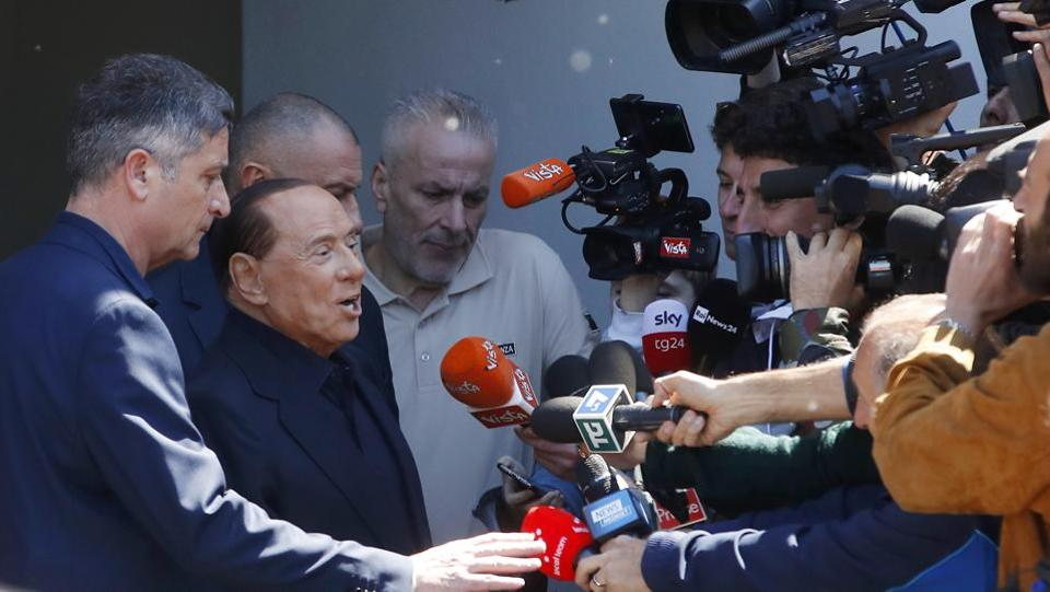 Former Italian Premier Silvio Berlusconi speaks to reporters as he leaves the San Raffaele hospital, in Milan, Italy. Berlusconi himself is running for European Parliament elections, the first time he has been allowed to run for public office following a ban imposed after a 2012 tax fraud conviction. (Antonio Calanni / AP)