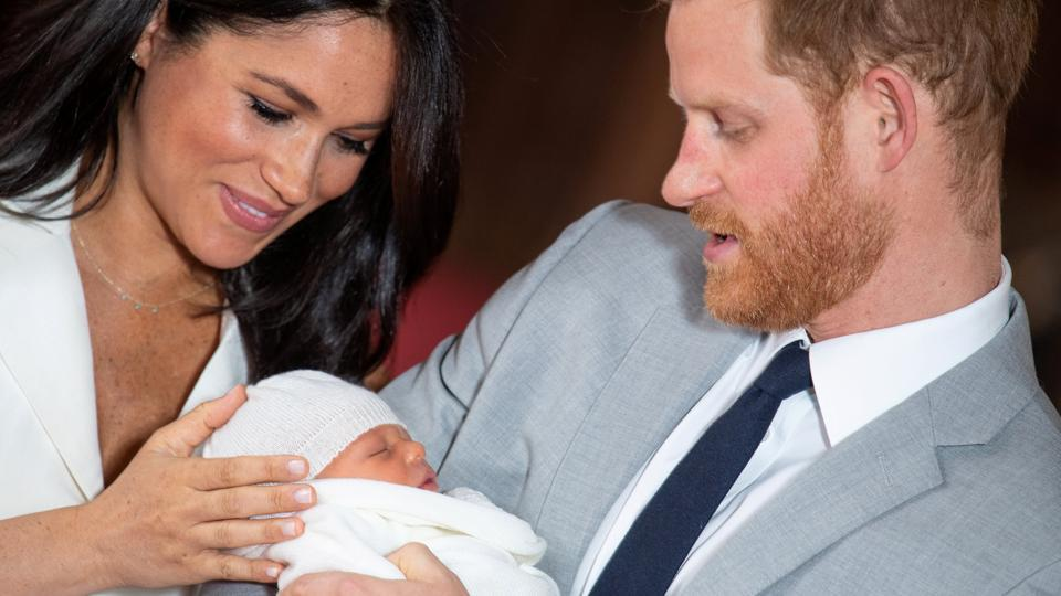 Britain's Prince Harry and Meghan, Duchess of Sussex hold their baby son, who was born on Monday morning, during a photocall in St George's Hall at Windsor Castle, in Berkshire, England. (Dominic Lipinski / Pool via REUTERS)