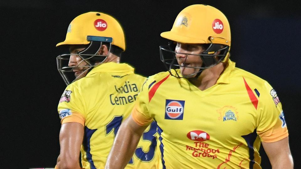 Chennai Super Kings cricketers Shane Watson (R) and Faf du Plessis run between the wickets.