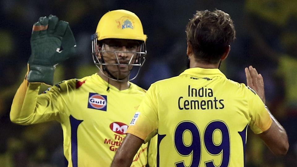 Imran Tahir and Mahendra Singh Dhoni of Chennai Super Kings.