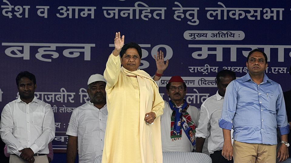 BSP President Mayawati waves at supporters during an election campaign rally for the Lok Sabha polls, in New Delhi. Addressing a rally in support of her party candidates in Northeast Delhi, she said no development was carried out for minorities, Dalits and backward castes in the last five years. Their condition was no different during the Congress' rule, she said. (Biplov Bhuyan / HT Photo)