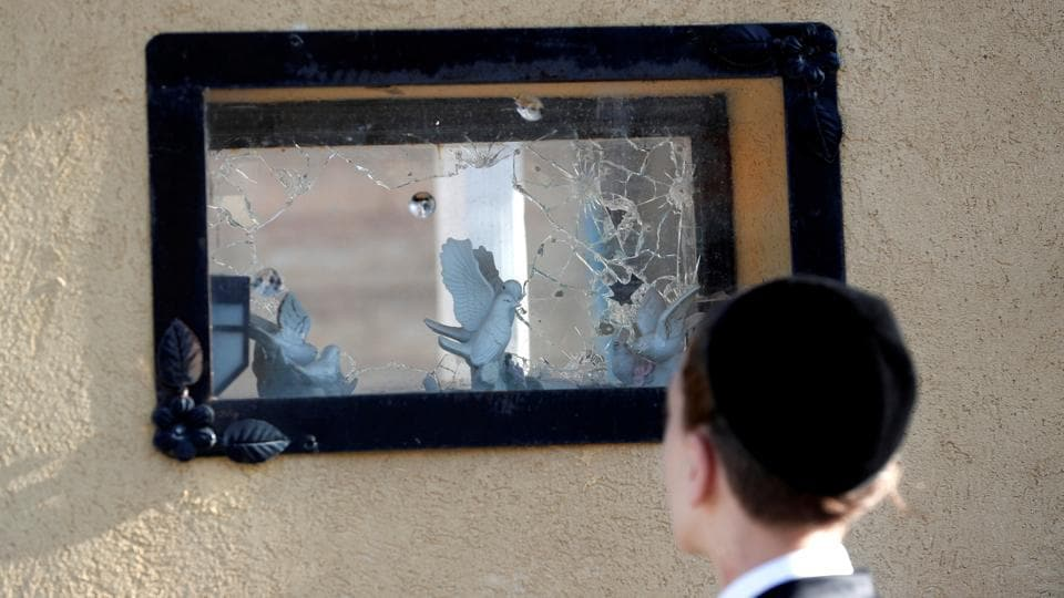 A boy looks at a damaged house after it was hit by a rocket, fired from Gaza over the border, to the Israeli side in Kiryat Gat, Israel. (Ronen Zvulun / REUTERS)