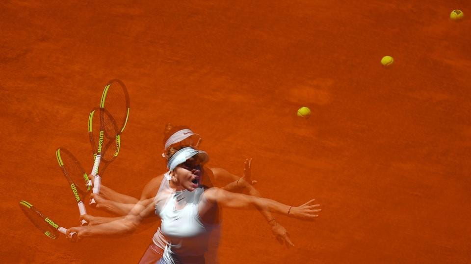 A multiexposure picture shows Romania's Simona Halep returning the ball to Australia's Ashleigh Barty during their WTA Madrid Open round of 8 tennis match at the Caja Magica in Madrid. Spain. (Gabriel Buoys / AFP)