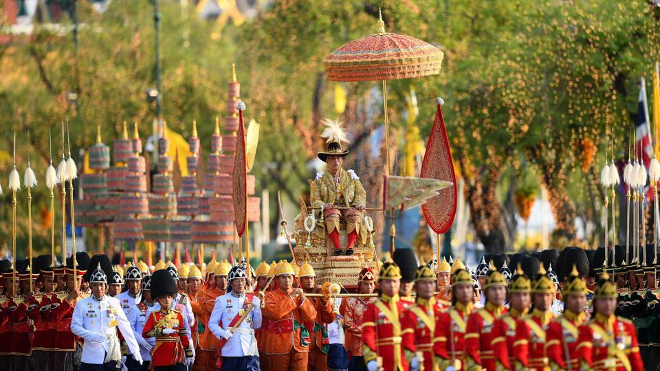 Thailand's King Maha Vajiralongkorn is carried in a golden palanquin during his coronation procession in Bangkok, Thailand. (Manan Vatsyayana / AFP)