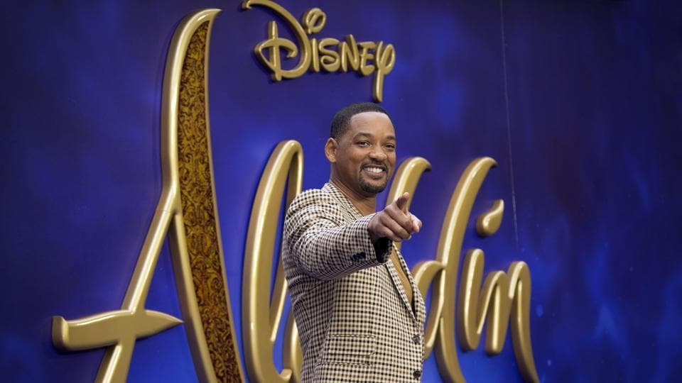 Actor Will Smith poses for photographers upon arrival at the Aladdin European Gala premiere in London.