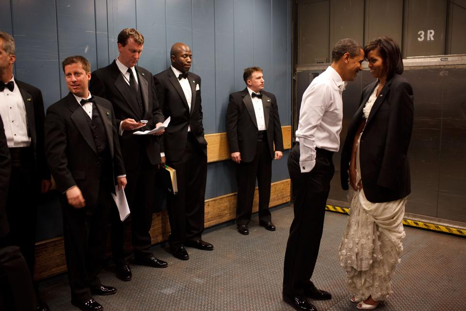 President Barack Obama and First Lady Michelle Obama lean into each other in an elevator, ahead of an inaugural ball.