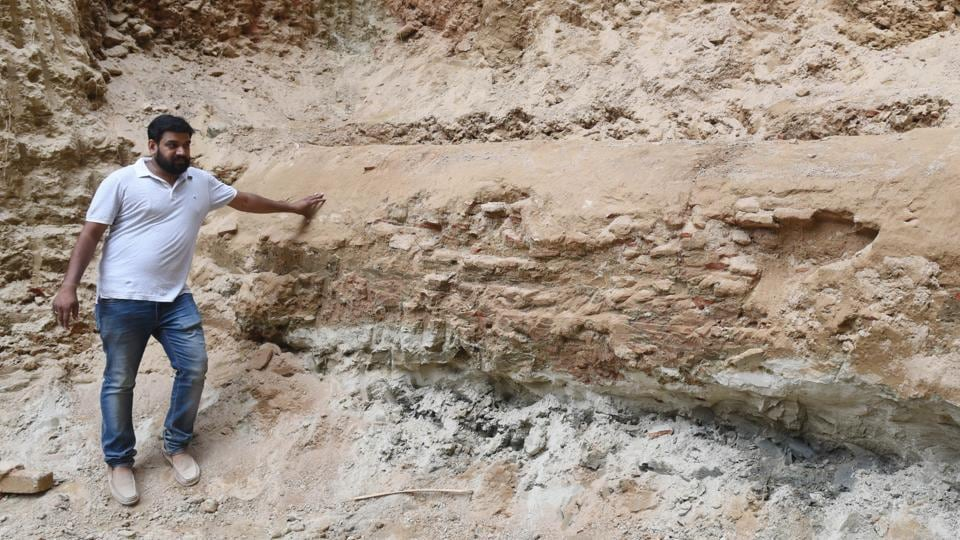 An official showing the newly unearthed tunnel-shaped structure at the Chhatar Manzil, Lucknow.
