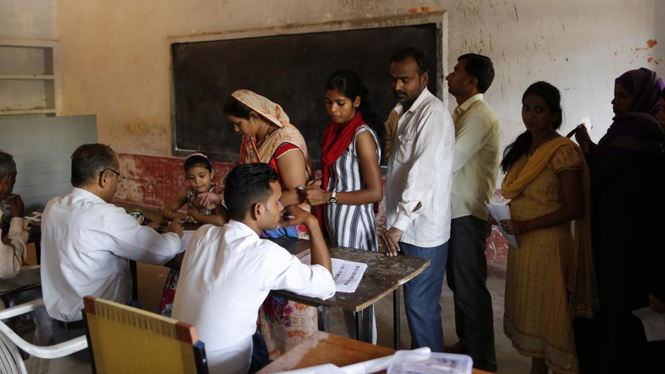 People queue up to cast their vote at a polling booth in Uttar Pradesh.