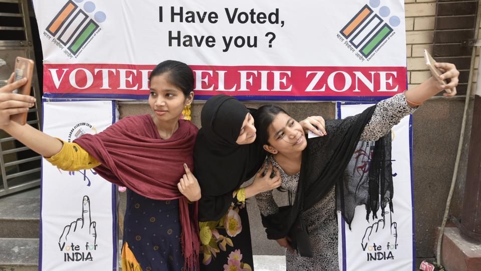 Voters take selfie during the sixth phase of Lok Sabha elections at Seelampur on 12 May 2019 in New Delhi, on Sunday, May 12, 2019.