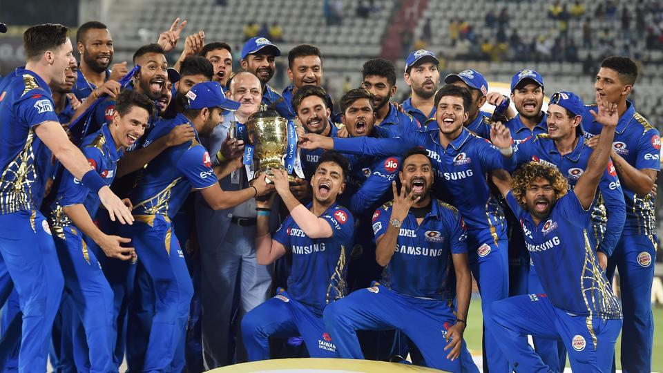 Mumbai Indians (MI) skipper Rohit Sharma with his teammates celebrating with Indian Premier League 2019 winning trophy. (PTI)