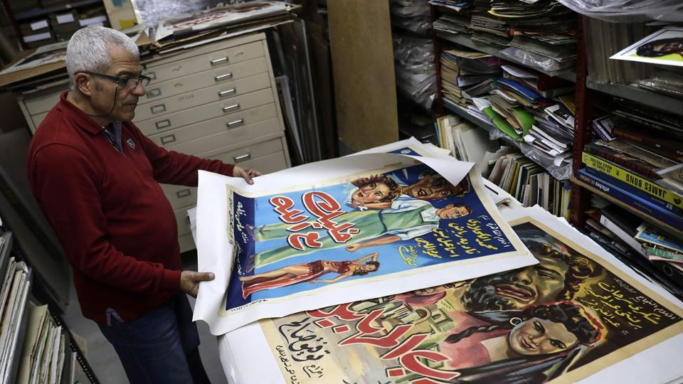 Abboudi Abu Jawdeh shows part of his vintage cinema poster collection at his office in the Lebanese capital Beirut. At a Beirut cultural centre, Lebanese film buff Abboudi Abu Jawdeh is exhibiting vintage film posters from his collection that show off a lost art, but also offer insight into decades of Western cliches of the Arab world. (Joseph Eid / AFP)