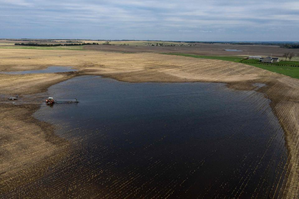 A tractor pumps water from a flooded field, near Orchard, Antelope County Nebraska. Already hurt by the US-China trade war, farmers in Nebraska are reeling from this year's devastating floods, which ravaged crops and left little time to plant for the next harvest. Damage from the March rains in the Midwest is visible across the landscape north of Omaha, the state's biggest city: trees have fallen, growing fields are caked in mud and rivers are at elevated levels. (Johannes Eisele / AFP)