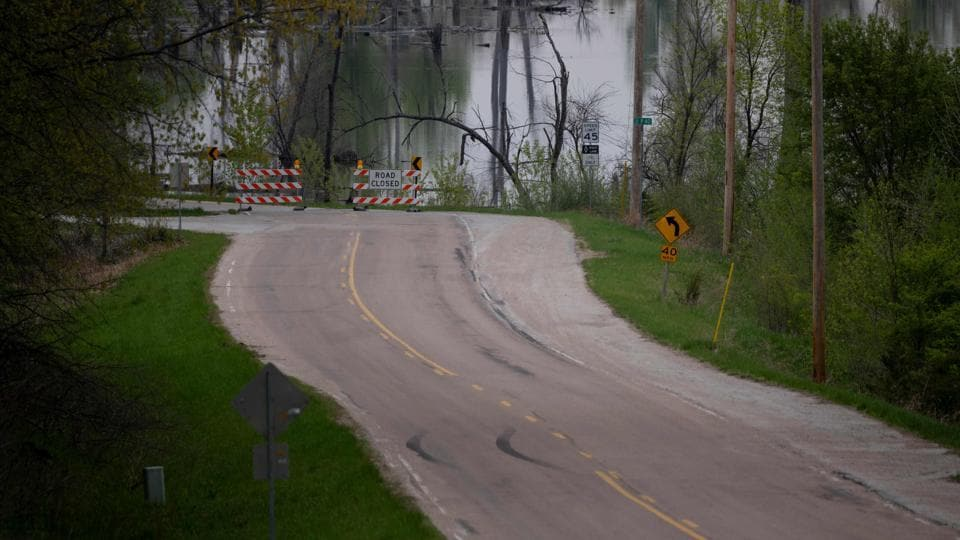 A sign reads, 'road closed,' near Omaha, Nebraska, as the Missouri River continues to flood, making neighbourhoods uninhabitable and cutting off public services. The floods came as farm incomes have fallen about 50 percent since 2013 due to low crop prices, leading to debt levels not seen since the 1980s. In the wake of the disaster, growers have been granted extensions on credit payments and loans, as well as the possibility in some cases to renegotiate loans at lower interest rates.  (Johannes Eisele / AFP)