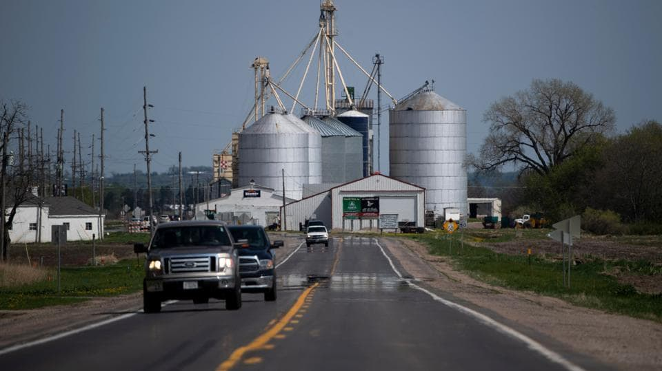 "The situation has also been exacerbated by the trade war with China, which has closed off a key consumer market for some growers, particularly for soybeans. The Ready family sells both soybeans and corn to China. ""It was our products that are most affected by that trade war,"" Sid Ready said. ""Does that mean that we are all very happy about it because it's costing us?"" he added. ""No, but we understand it."" ""In the long run, we hope it works."" (Johannes Eisele / AFP)"