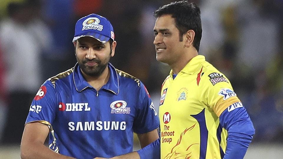 Mumbai Indians captain Rohit Sharma, left and Chennai Super Kings captain Mahendra Singh Dhoni greet each other.
